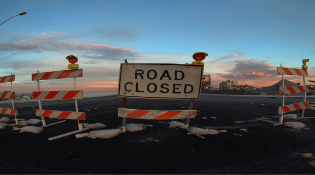 road closed sign with barriers